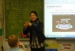 5 and 6 Year students learning Chinese with their teacher Tianjing
