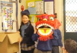 Year 5 and 6 students playing acting lion dance